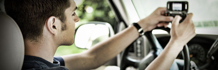 Man using a cellphone while driving