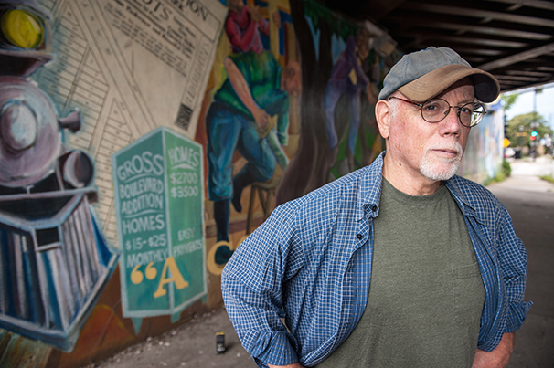 Neil Shapiro (photographed by neighbor Gordon W.) stands in front of his mural showing the evolution of the Villa neighborhood on Chicago's NW side