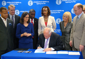 Gov. Pat Quinn and Attorney General Lisa Madigan came to CUB in the summer of 2012 to sign into law one of the nation's toughest anti-cramming laws for landline bills.