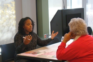 Yami, CUB's Community Technology Liaison, gets animated discussing utility bills